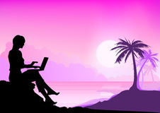 Working Beach Girl. Girl working on a laptop with a tropical beach in background Stock Photos