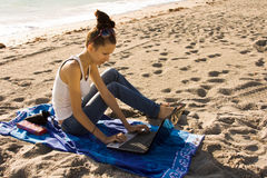 Working from the Beach Royalty Free Stock Images
