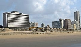 Working the beachfront. Sand mounds and a digging machine at Durban south beach Stock Images