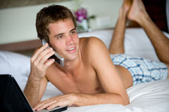 Working On Bed Stock Photography