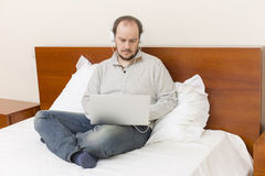 Working in bed Royalty Free Stock Photography