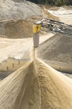 Working belt conveyor and stone meal in Gravel Quarry Stock Images