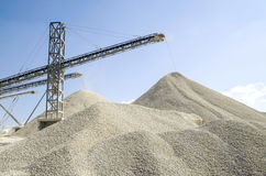 Working belt conveyors and a piles of rubble in Gravel Quarry Royalty Free Stock Images