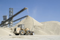 Working belt conveyors and a piles of rubble in Gravel Quarry Royalty Free Stock Photos