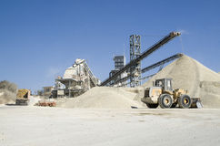 Working belt conveyors and a piles of rubble in Gravel Quarry Royalty Free Stock Photo