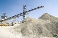 Working belt conveyors and a piles of rubble in Gravel Quarry Royalty Free Stock Photography