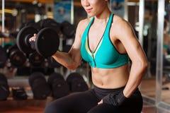 Working on biceps Stock Photos