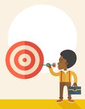 Working black man holding a target arrow. A working black man with strategy on how to get his target market sales higher. Market strategy concept. A Contemporary Royalty Free Stock Photos