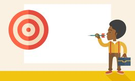 Working black man holding a target arrow. A working black man with strategy on how to get his target market sales higher. Market strategy concept. A Contemporary Royalty Free Stock Photography