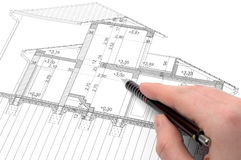 Working with blueprints. Hand showing on a section plan Stock Photography