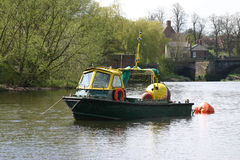 Working Boat. Small Working River Boat on the River Dee in Chester Stock Images