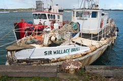 Working boat mooring in harbour royalty free stock image