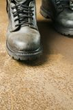 Working-boots on rusty floor. Boots and laces standing in a rusty surrounding royalty free stock images