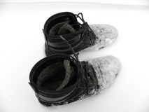 Working boots winter wet, cold, dirty snow Stock Photography