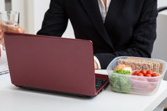 Working boss with light meal Stock Photos