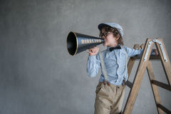 Working boy. Little producer with a megaphone stock image