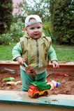 Working boy playing in a sandbox Stock Photo