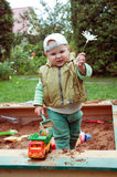 Working boy playing in a sandbox. With a car Royalty Free Stock Photos