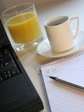 Working Breakfast 2. Coffe, juice and laptop royalty free stock images