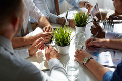 Working briefing. Team of specialists analyzing financial or trade statistics royalty free stock image
