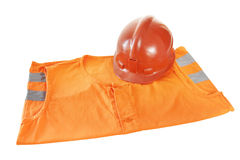 Working bright orange vest and a helmet Royalty Free Stock Photography