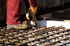 Working builder. Concrete steel reinforcement.Working builder royalty free stock photo