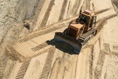 Working bulldozer. Yellow bulldozer on work area Stock Photography