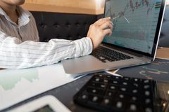 Working business man of broker or traders thinking about forex on multiple computer screens of stock market invest trading. Financial graph charts data analysis stock photo
