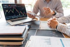 Working business man, team of broker or traders talking about forex on multiple computer screens of stock market invest trading. Financial graph charts data stock photo