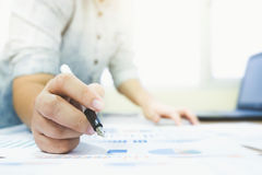 Working business people analyse high performance marketing data Stock Photos