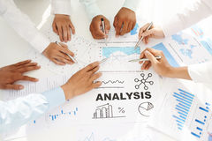 Working with business reports Stock Photography