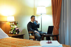 Working businessman in a hotel room