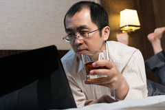 Working businessman in hotel Royalty Free Stock Image