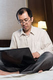 Working businessman in hotel Stock Photo