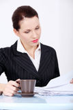 Working businesswoman with mug. Stock Photography