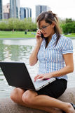 Working businesswoman outdoor Stock Image