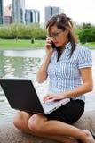 Working businesswoman outdoor Stock Image