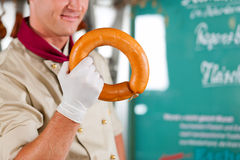 Working in a butcher's shop Stock Image