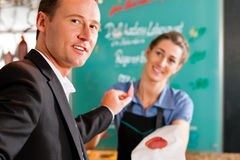 Working in a butcher's shop Royalty Free Stock Photography