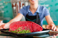Working in a butcher's shop Royalty Free Stock Photo