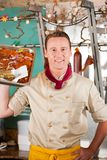 Working in butchers shop with barbeque meat Stock Photography