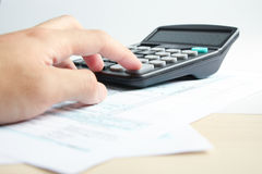 Working with a calculator Royalty Free Stock Images