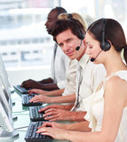 Working in a call centre. Potrait of people working in a call centre Royalty Free Stock Image