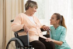 Working in care home. Young attractive women working in care home Stock Photography