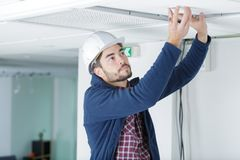 Working on a ceiling royalty free stock photography