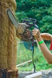 Working chainsaw Stock Photos