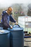 Working Chemical Blender in Corrosive Area of Plant. Chemical Plant. Man working in protective gear, safety glasses, respirator, and gloves, blends chemicals in stock photos