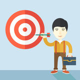 Working chinese man holding a target arrow. A working chinese man with strategy on how to get his target market sales higher. Market strategy concept. A Stock Images