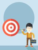 Working chinese man holding a target arrow Royalty Free Stock Image