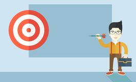 Working chinese man holding a target arrow. A working chinese man with strategy on how to get his target market sales higher. Market strategy concept. A Royalty Free Stock Image